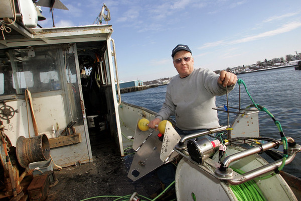 Gloucester Bill Lee of Rockport will head out tomorrow morning on his boat The Ocean Reporter to use the underwater camera he's holding to photograph the wreckage of the Patriot as part of the investigation into the sinking of the fishing vessel. Mary Muckenhoupt/Gloucester Daily Times