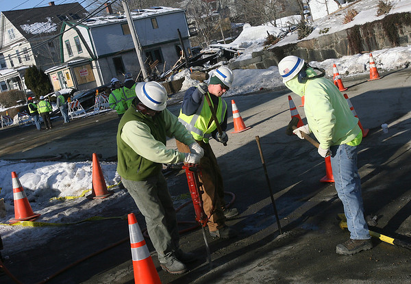 Gloucester: National Grid employees work on gas lines near 76 Eastern Ave., where a home exploded Sunday morning, critically injuring Gloucester Police Officer Wayne Sargent. Photo by Kate Glass/Gloucester Daily Times Monday, January 26, 2009