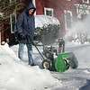 Manchester: Chris Graves uses a snow blower to clear his driveway on Forest Street Thursday monring.  Mary Muckenhoupt/Gloucester Daily Times
