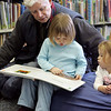 "Gloucester:  David Lufkin reads ""Good Night Moon"" with his daughter Ella Anderson-Lufkin, 3, at the Sawyer Free Library as April Smith, 2, right, looks on Saturday afternoon. Mary Muckenhoupt/Gloucester Daily Times"
