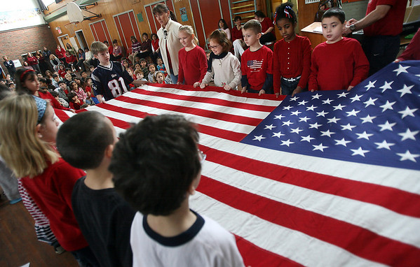 Gloucester: Students in Mrs. Sheridan's third grade class demonstrate how to properly fold an American flag during a school assembly at Beeman Elementary yesterday. Students recited facts about inaugurations, created an inaugural alphabet, and sang patriotic songs. Photo by Kate Glass/Gloucester Daily Times Tuesday, January 20, 2009