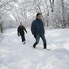 Manchester: Michael and Kimberly Hildebrand of Beverly snowshoe through the woods off School Street in Manchester on Monday afternoon. Photo by Kate Glass/Gloucester Daily Times Tuesday, January 19, 2009