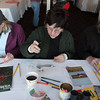 Gloucester: From left, Carrie Hughes of Lebanon, N.H., Caroline Haines of Gloucester and Betsy Carter of Rockport work on their bird drawings at the Elks Club Saturday afternoon. Bird drawing was just one of the activities offered during the Cape Ann Winter Birding Weekend sponsored by the Cape Ann Chamber of Commerce. Mary Muckenhoupt/Gloucester Daily Times