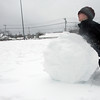 Rockport: Joseph Ryan, 7, of Rockport builds a massive snowball at Evan's Field Wednesday afternoon. He was not sure if it was going to be the base for a snowman or if he was just going to make a really large snowball. Photo by Kate Glass/Gloucester Daily Times Wednesday, January 28, 3009