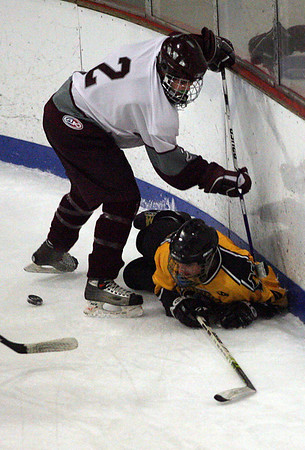 Gloucester: Rockport's Sean Golden steals the puck from underneath Northeast's Zack Allen during the Vikings' 3-2 win last night. Photo by Kate Glass/Gloucester Daily Times Monday, January 5, 2008