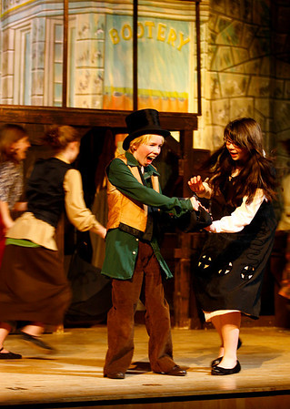 """Rockport: Sam Roell as Oliver is caught with the purse of Andrea Waldron as Mrs. Brownlow during Rockport Middle School's production of """"Oliver!"""" The show will run tonight, tomorrow and Sunday at 7:30 in the John E. Lane Auditorium. Photo by Kate Glass/Gloucester Daily Times Thursday, January 29, 2009"""