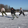 Gloucester: From left: Jesse Downey, Lenny Muise, Mike Muniz, and Chris Bertolino play hockey on Niles Pond yesterday afternoon. The group of friends spent several hours shoveling fresh snow for prime ice. Photo by Kate Glass/Gloucester Daily Times Monday, January 12, 2009
