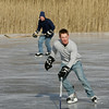 "Rockport: Patrick Keating, front, skates for the puck ahead of his father Kerry while playing hockey at Camborne Pond Saturday afternoon. ""We're just gettig a little exercise,"" said Kerry who was also playing hockey with his other son Corbin. Mary Muckenhoupt/Gloucester Daily Times"