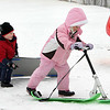 Gloucester: Abby Wedd, 6, heads back up the hill with her sled scooter as kids enjoy a day of sledding at Stage Fort Park Friday. Also pictured is Yishai Howe, 5, left. Mary Muckenhoupt/Gloucester Daily Times