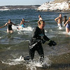 Gloucester: Over a dozen people, including Debra Christophi, front, particiapted in the annual Rocky Neck Plunge at Oak Grove Beach Thursday morning.  Mary Mucknhoupt/Gloucester Daily Times
