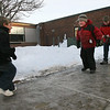 Rockport: Michael Wonson, 6, Jacob English, 6, and Jared English, 9, slide across ice outside Rockport Elementary School yesterday afternoon before heading home. Jacob suggested they get a mini zamboni to make the ice smoother. Photo by Kate Glass/Gloucester Daily Times Monday, January 26, 2009