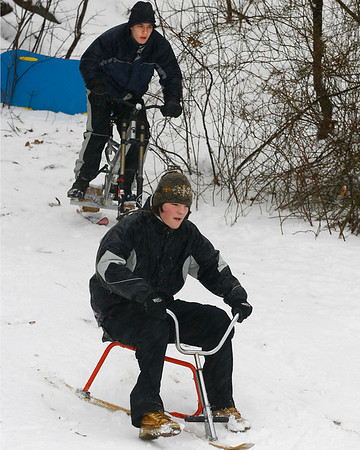 Rockport: Isaac Perry, front, and Brian LaPointe ride snowbobs at Evans Field on Wednesday. Perry found his at a thrift store while LaPointe made his. Photo by Kate Glass/Gloucester Daily Times Wednesday, January 28, 2009