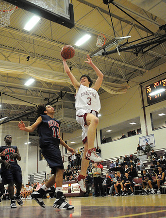 Gloucester: Gloucester's Chris Peritore goes up for a layup against Revere's Matt Handy last night at Benjamin Smith Feildhouse. Photo by Desi Smith/Gloucester Daily Times Tuesday, January 27, 2009