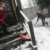 Christopher Perley, 10, and Alonzo Bergmann clear snow from their Maplewood Ave home yesterday. Photo by Kate Glass/Gloucester Daily Times Wednesday, January 28, 2009