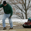 Gloucester: Rick Silveira of Gloucester pulls his kids Garrett, 5, and Helia, 7, on a sled at Stage Fort Park Saturday afternoon.  Garrett and Helia had been looking at seals playing in the water just off Cressy's Beach with their dad's binoculars. Mary Muckenhoupt/Gloucester Daily Times