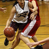 Rockport: Rockport's Tia Nelson dribbles around Amesbury's Colleen Brockmyre during their game at Rockport last night. Photo by Kate Glass/Gloucester Daily Times Monday, January 12, 2009