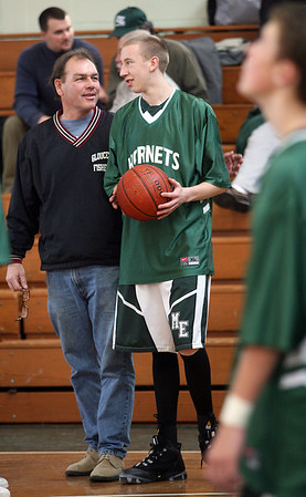 Manchester: Former Manchester Essex and current Gloucester boys basketball coach chats with Manchester Essex's Joe Mussachia before their game against North Andover yesterday afternoon. Photo by Kate Glass/Gloucester Daily Times Monday, January 19, 2009