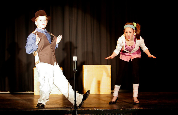 """Manchester: Fifth graders Alex Buck as Legs and Julia Bonaccorso as Trixie rehearse a scene from Manchester Memorial Elementary School's production of """"Give My Regards to Broadway"""" yesterday afternoon. The show, which features the fifth grade, will be performed at the school this afternoon at 4 and Thursday and Friday at 7. Photo by Kate Glass/Gloucester Daily Times Tuesday, January 13, 2009"""