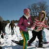 Manchester Ashley Deschenes, center, helps her friend Nicole D'Ambrosio walk as Eric Magers' eigth grade Project Adventure class goes out snow shoeing Thursday monring.  The class walks out on the Essex County Club golf course for about a mile before returning back to the school.  Deschenes said she likes snow shoeing because they get to go outside but she doesn't like falling down in the snow. Mary Muckenhoupt/Gloucester Daily Times