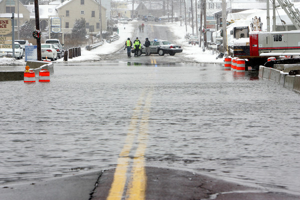 Essex: A section of Main Street was closed due to the causeway flooding Saturday afternoon. Mary Muckenhoupt/Gloucester Daily Times