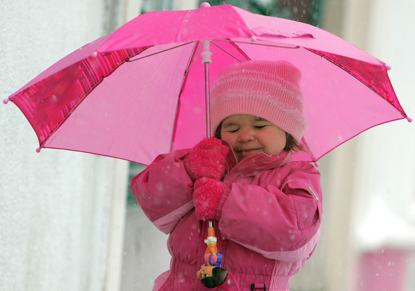 Gloucester: Arianna Lynn Bruni, 2, of Gloucester closes her eyes and holds onto her unbrella tight as a big gust of wind comes wipping down Main Street Saturday afternoon.  Mary Muckenhoupt/Gloucester Daily Times