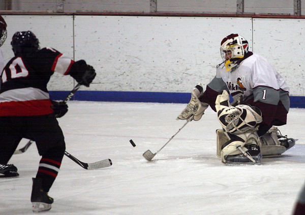 Gloucester: Rockport's Colby Foster deflects a shot away from the net during their game against Salem at the Talbot Rink last night. Photo by Kate Glass/Gloucester Daily Times