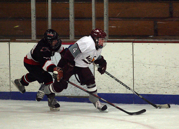 Gloucester: Rockport's Mike Tupper keeps ahead of Salem's Zach Holt during their game at the Talbot Rink last night. Photo by Kate Glass/Gloucester Daily Times