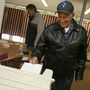 Gloucester: Alfred Piscitello casts his vote at the Veterans' Center in Gloucester yesterday morning. Photo by Kate Glass/Gloucester Daily Times