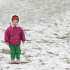 Manchester: Maggie Light, 3, stands on a little patch of sand at Singing Beach while waitig for her babysitter Lane Taylor after the two walked the beach Friday afternoon. Mary Muckenhoupt/Gloucester Daily Times
