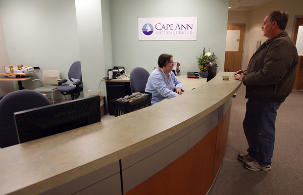 Gloucester: Joyce LoPiccolo greets Tim Gallagher in the main lobby of Cape Ann Medical Center's new location at One Blackburn Drive. Photo by Kate Glass/Gloucester Daily Times