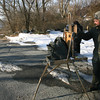 Gloucester: Caleb Stone of Gloucester dressed for the weather to paint a winter scene of Plum Cove yesterday afternoon. Warmer temperatures are expected toward the end of the week. Photo by Kate Glass/Gloucester Daily Times Monday, January 11, 2010