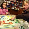 "Manchester: Bella Leonard, right, smiles as she draws a ""Sorry!"" card, sending one of Elizabeth Staid's pieces back to the start as they play board games at the Manchester Library on Tuesday afternoon. Photo by Kate Glass/Gloucester Daily Times"