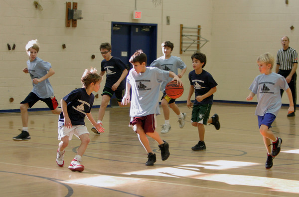 Essex: Jake Rich dribbles the ball down the court duing a youth basketball game for Manchester and Essex fifth and sixth graders at the Essex Elementary School Saturday afternoon. Mary Muckenhoupt/Gloucester Daily Times