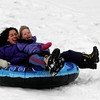 Rockport: Gillian Twombly and her daughter, Abigail, scream as they go sledding at Evan's Field in Rockport. Because of the wet snow, there was a large puddle at the bottom of the hill, but with two people on the sled they could get enough speed to go over it. Photo by Kate Glass/Gloucester Daily Times