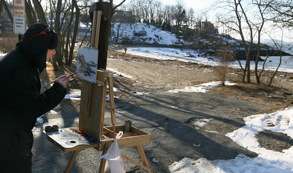 Gloucester: Chris Coyne of Rockport paints a winter scene of Plum Cove yesterday afternoon while out with fellow painter Caleb Stone of Gloucester (not shown). Warmer temperatures are expected toward the end of the week. Photo by Kate Glass/Gloucester Daily Times Monday, January 11, 2010