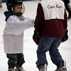 Gloucester: Sean Bergin, 4, of Gloucester reaches for his older brother, Jack, 9, as they skate at the Talbot Rink during Cape Ann Youth Hockey Night last night. Jack, who is on the Squirt travel team, was teaching Sean some skating pointers. Photo by Kate Glass/Gloucester Daily Times