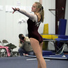 Gloucester: Kelly Benson of the Gloucester Ipswich squad begins her floor routine during the meet against Manchester Essex Hamilton Wenham at the Iron Rail Gymnastics Academy in Gloucester last night. Photo by Kate Glass/Gloucester Daily Times