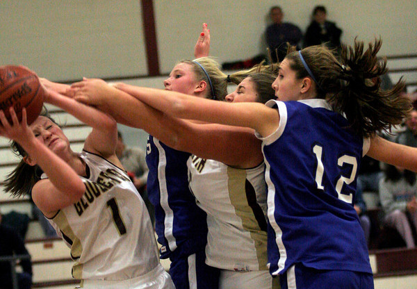 Gloucester: Gloucester's Audrey Knowlton tries to scoop up a rebound as Danvers' Allison Tivnan, Gloucester's Mary Unis, and Danvers' Kellie Macdonald reach for the ball at the Benjamin A. Smith Field House last night. Photo by Kate Glass/Gloucester Daily Times