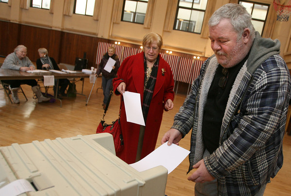 Gloucester: From right: Michael Magee, Judith Magee, and Bonnie Sweet cast their ballots at the Our Lady of Good Voyage Youth Center yesterday afternoon. As of 12:30, the polling location already had more voters than had voted in the primary. Photo by Kate Glass/Gloucester Daily Times