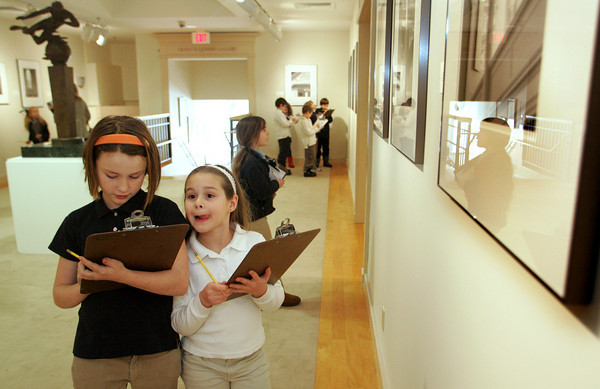 "Gloucester: Elaine Turner, left, and Sarah Bradshaw, students for the Easter Point Day School, work on their scavenger hunt to find different types of architecture from Steve Rosenthal's photo exhibit ""Churches of Rural New England"" at the Cape Ann Museum Wednesday afternoon.  Once a week the group of second, third, and forth grade students go to either the Cape Ann Museum of the Heritage Center to learn new things outside the classroom. Mary Muckenhoupt/Gloucester Daily Times"