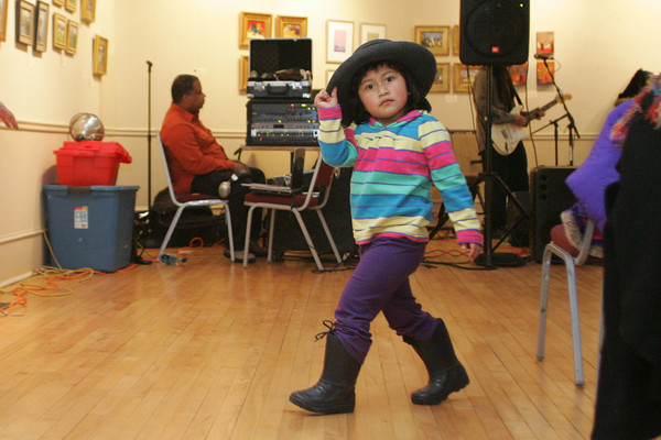 Rockport: Ani Stephan, 3, dances to the band Wildest Dreams, an afro-pop reggae band which played at the Rockport Art Association for New Year's Rockport Eve. Mary Muckenhoupt/Gloucester Daily Times