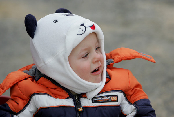 Gloucester: Logan Jacques, 20 months, looks at a big truck going down Washington Street while out for a walk with his mother to go visit his nana Thursday afternoon. Mary Muckenhoupt/Gloucester Daily Times