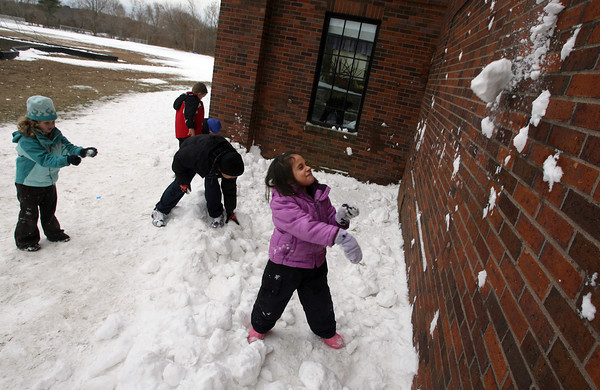 Rockport: Mya Doucette makes a face as snow flies into her face as she and other students at Rockport Elementary School's after school program try to see who can throw a snowball the highest yesterday afternoon. Photo by Kate Glass/Gloucester Daily Times Tuesday, January 5, 2009