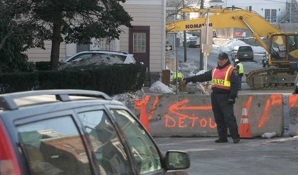 Gloucester: Gloucester Police Officer Cliff Alves directs traffic down Dale Ave. as part of the detour around construction on Prospect Street yesterday. Alves says it is surprising how many people drive right up to him and wonder why they cannot get through. Photo by Kate Glass/Gloucester Daily Times