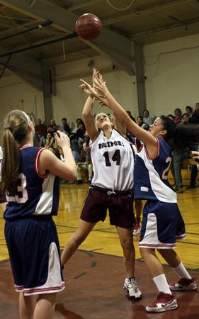 Rockport: Rockport's Morgan Weir leaps above Lynn Tech's Claribelle Ramirez at Rockport High School last night.