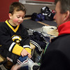 Gloucester: Drew White, 4, gets some help taking off his skates from his dad, Tim, at the Talbot Rink during Cape Ann Youth Hockey Family Night on Monday night. Photo by Kate Glass/Gloucester Daily Times