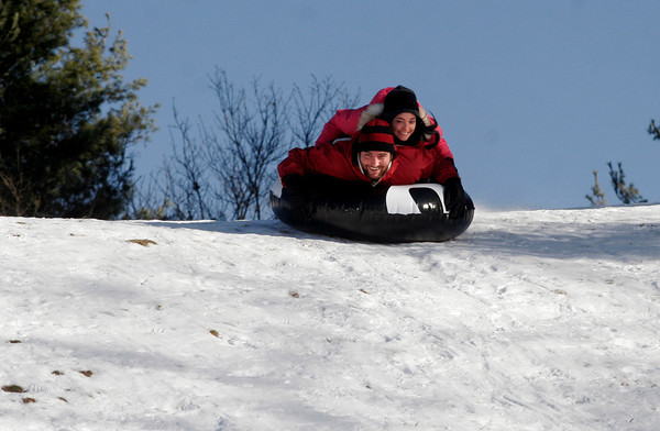 Manchester: Kansas Ricci-Munn and Jaime Asar of Gloucester enjoy an empty sledding hill at the Essex County Club on Thursday afternoon. Photo by Kate Glass/Gloucester Daily Times