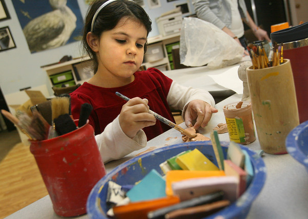 "Gloucester: Jillian Gibbs, 8, glazes her sculpture at Cape Ann Art Haven during a pottery class on Tuesday afternoon. ""I made this using scraps from other pieces,"" she says. Photo by Kate Glass/Gloucester Daily Times"