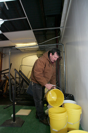 Rockport: Supervising and Grounds Supervisor Ed Quick empties rain buckets in an unused athletic room off the gymnasium at Rockport High School Thursday morning.  Maschusetts School Building Authority recently approved funding for nearly half the cost of the roof replacement for Rockport Middle/High School.  Mary Muckenhoupt/Gloucester Daily Times