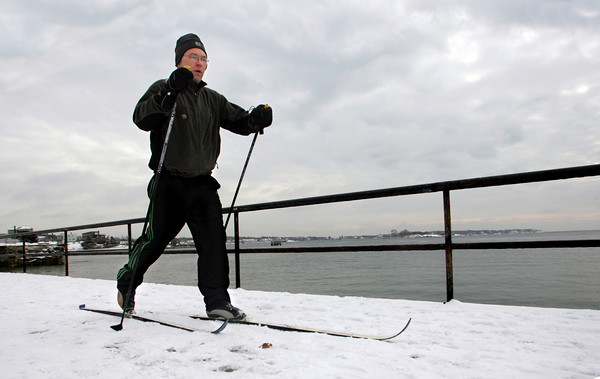 "Gloucester: James Pierce takes advantage of the fresh snow by cross county skiing down Stacy Boulevard Friday morning. ""Nothing like skiing on the water,"" said Pierce. Mary Muckenhoupt/Gloucester Daily Times"